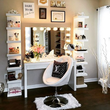 One vanity design that has been popping up quite a lot are the ones shown above and below. This design incorporates a trendy desk, some basic shelf units and a mirror framed with LED lights.