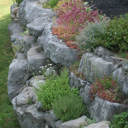 Making your own artificial rocks is a cost effective way to add interest to garden landscaping or design unique water features.