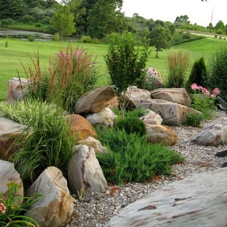 Not only are artificial rocks much lighter than the real thing, it's not easy to find large rocks that can be easily transported for installation in a garden setting.