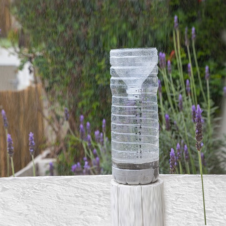 A rain gauge allows you to keep track of summer or winter rainfall, and this simple rain gauge is made by recycling a plastic juice bottle.