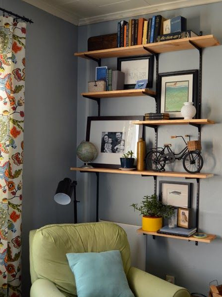 Do away with melamine shelves and add personality with wood or reclaimed timber shelves. You can even cut down pallet wood to make your own shelves.