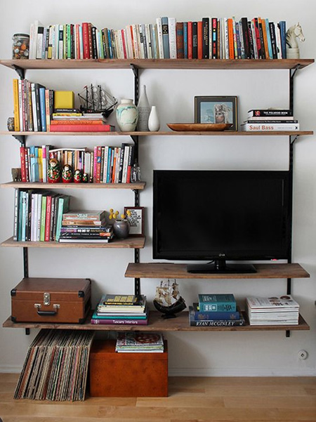 Steel shelving is also a great way to display your TV if you don't have room for a TV cabinet or media console. You can disguise electical wires by fastening these to the steel frame so that they aren't messy.