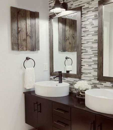 Ditch the melamine countertop and fit a floating bathroom vanity with a 'his' and 'hers' basin. Bring in complementary accessories that finish off the look. Framed mirrors are easy to make and can be stained or painted to match the decor.