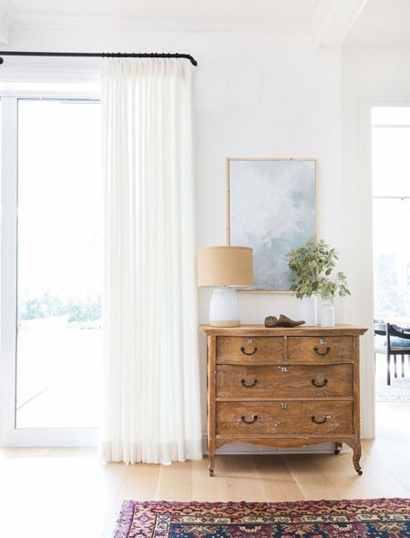 Once you have decided on the exact height and width you want for your curtains, grab a tape measure, pencil and notepad to jot everything down. With these measurements in hand you can shop for rod and rails, and have custom curtains made, or look at your choices for ready made curtains.