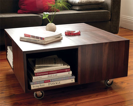 This mobile coffee table has compact storage for a living room. The basic cube design is easy to assemble and you can stain and seal in your choice of wood tint.