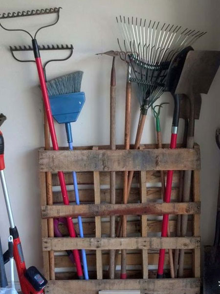 In the absence of a garden shed, garages end up as a place to dump garden tools and accessories. An easy way to organise and store these is to create a storage, or hanging rack, where they can be placed. A reclaimed pallet is a very easy way to make a storage rack for all your garden tools - no effort required.