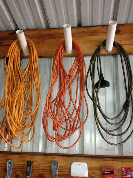 Extension cords for lawnmower, weedeaters and the like can quickly become tangled and damaged. A nifty way to store all your extension cords is to make a simply hanger where they can be hung when not in use.