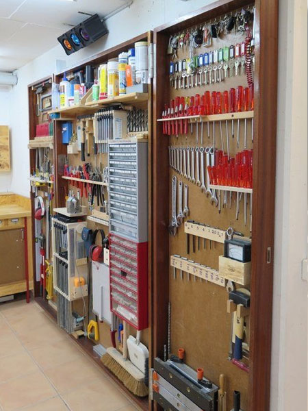 If you prefer to keep your tools and bits and bobs out of sight, it's easy to knock up a small wall cabinet with doors that can be fully opening for when you need access to tools and such.