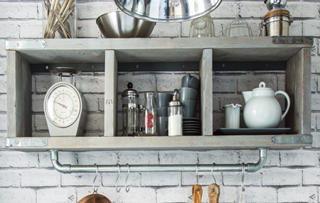 Use reclaimed pallets or scaffolding planks to make a stylish industrial shelf.