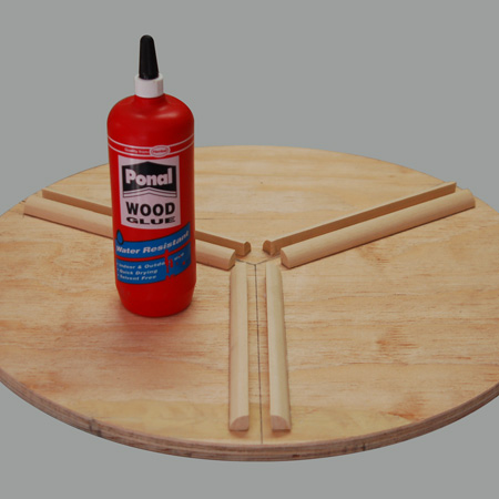 The quarter-rounds were glued to the table with Ponal wood glue. Press down hard and wipe away any excess glue that oozes out.