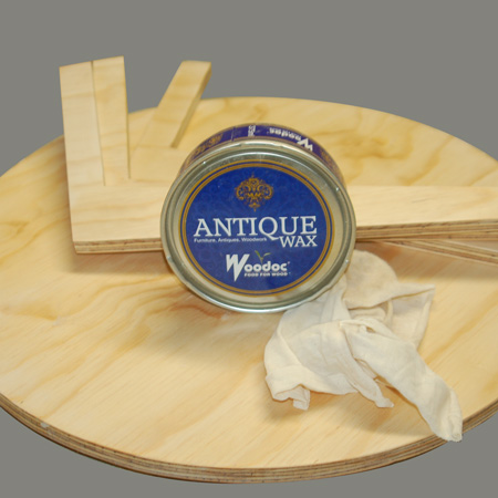 After sanding, wipe down and then apply Woodoc Antique Wax. If you prefer, you can also use a stain and sealer, tinted sealer, varnish. whitewash, or paint the table or table top. I wanted to have a more natural finish in line with Danish trends.