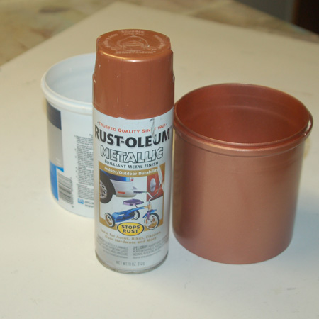 HOME-DZINE | Clean the plastic paint pot and make sure it's dry before spraying on a couple of coats of your choice of Rust-Oleum Metallic spray paint. Apply light, even coats to prevent drips and runs. Rust-Oleum have a range of metallic paints to choose from, and you will find the full range at your nearest Builders Warehouse