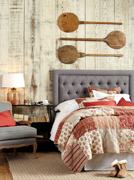 In a bedroom, it's so easy to introduce warm colours with bed linens. Look for bedding sets that incorporate deep, warm reds and pair these with shades of grey to add spice and warmth to the room.