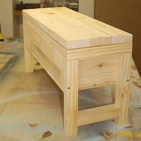 DIY Pine bathroom storage bench with lid closed.