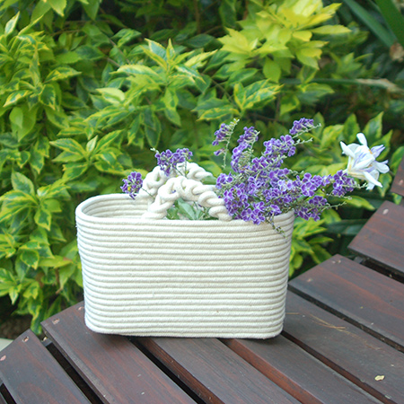 Here's a very simply way to make your own rope baskets. You can find sash cord at your local Builders store.