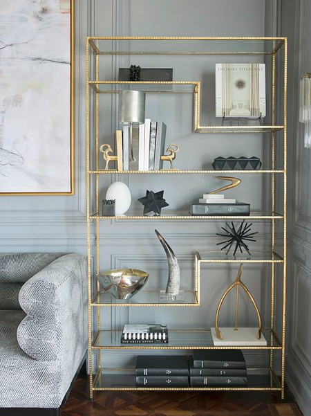Use Rust-Oleum metallic spray paint to finish off a welded steel display cabinet. The warmth of gold instantly heats up a grey colour scheme.