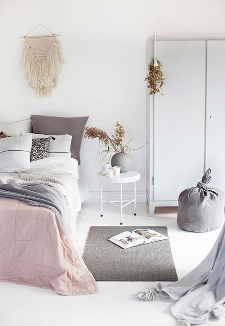 Blush pink and coral pink have been popping up a lot in designer-decorated homes, with pink accessories adding a splash of colour to grey spaces.