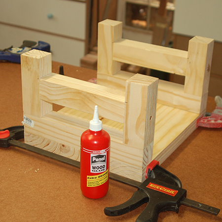 6. Small step stool: Glue the legs to the slat seat.