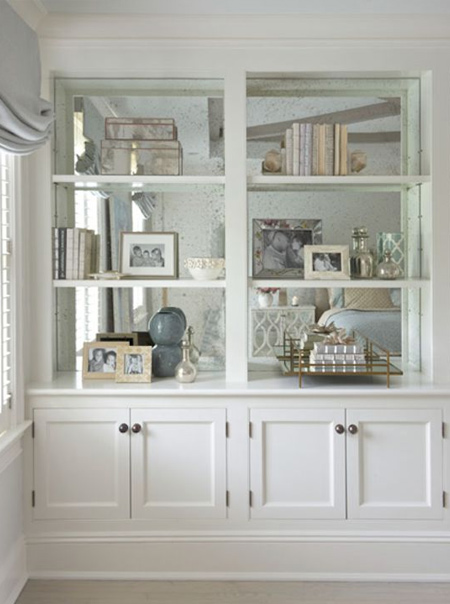 If you're handy with power tools and like to get stuck into DIY projects, an alcove is the perfect place to install built-in cupboards for extra storage space. If you don't need more storage, design built-in cupboards that add a decorative touch to alcoves, such as display cabinets with shelves and mirror backing.