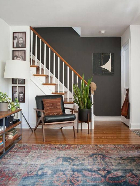 Not quite black - a charcoal wall provides the perfect canvas for light walls and dark accent pieces.