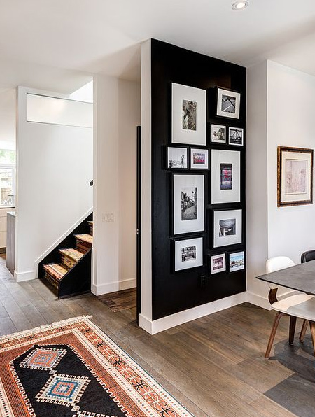 Sure to catch attention, an undiluted black wall provides the perfect canvas for a wall gallery and you don't have to worry about overdoing it with black.
