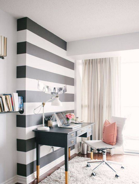 Even a small dose of black can go a long way. Black and white stripes provide a high-contrast, modern vibe when paired with traditional furniture.