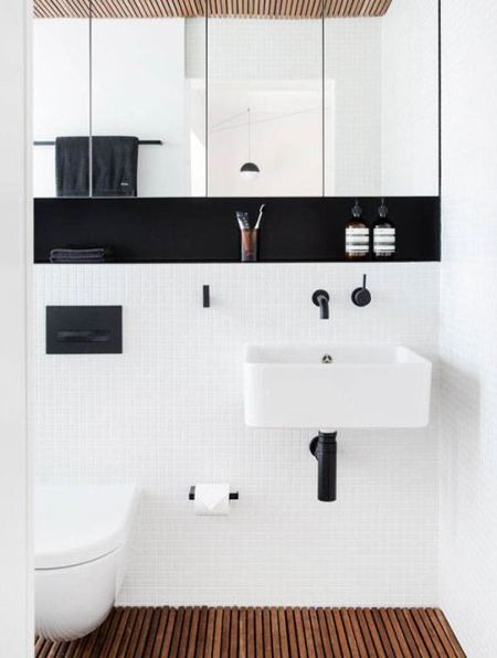 Black is bold, and the perfect touch for a white bathroom that needs a sophisticated edge.