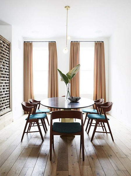 Perfect example of how curtains up to the ceilling make a small dining room appear much larger than it is.