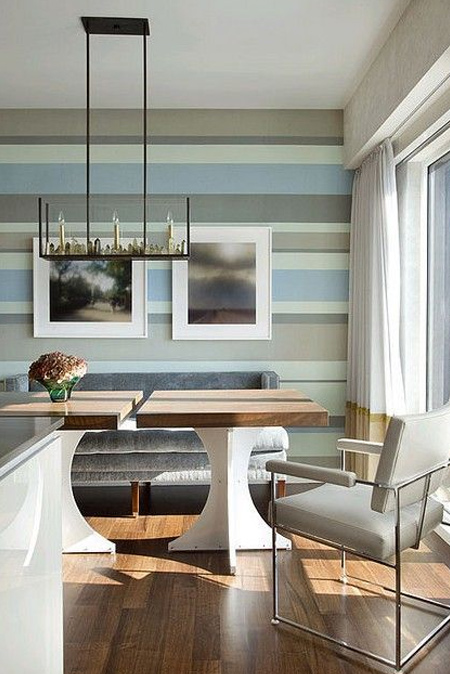 Horizontal stripes on a wall don't have to be in a single colour - tone-on-tone stripes can be used to introduce colour and interest to a plain room. Take colours from the room, tone these down, and paint onto a wall to instantly make a room feel larger.