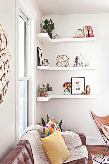 In a small home, rather than take up valuable floor space with bulky furniture, look at how you can use walls for display and storage. Get crafty and make your own floating shelves.