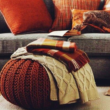 This knitted pouffe is so easy to make, you could make more than one! A knitted pouffe adds warmth and texture to the winter home and is great for lounging in front of the fire.