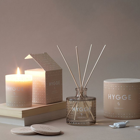 Hygge is more a lifestyle than anything else; it's a way of relaxing with family and friends or surrounding yourself with things that make you feel good. This winter, fill your home with warmth and texture and snuggle up with your family.  The warm glow of candlelight is hygge.