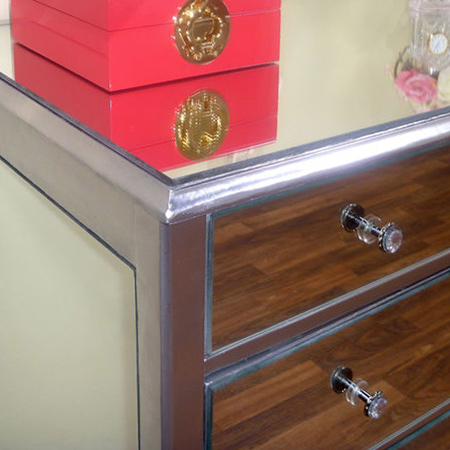 Now you can attach your sparkly handles and/or knobs. Gelmar have a wonderful range of diamond knobs that really add shine to mirrored furniture