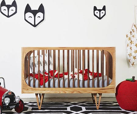 The Harrison Cot is inspired by fifties design