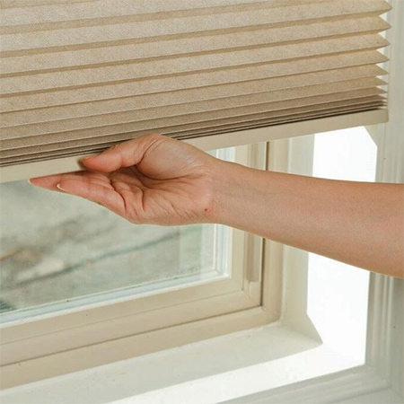 Honeycomb blinds from Finishing Touches offer an energy efficient way to warm up a home