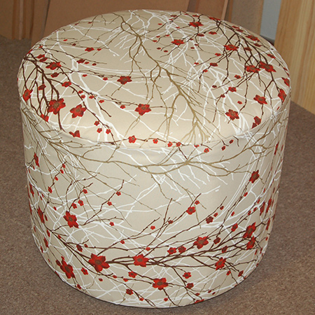 Nancy and Lindiwe made a circular upholstered ottoman. Comfortable, sturdy and lightweight, you can easily make your own circular ottoman and upholster in your choice of fabric.