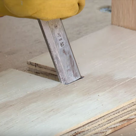3. Mark the location for cutting out slots to join the shelves together. Cut out with a jigsaw and then clean up the edges with a sharp wood chisel.