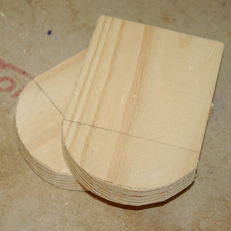 Use a jigsaw and clean-cut blade to cut the curve