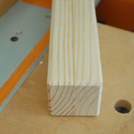 GOOD TO KNOW: If you have a router, rout a chamfered edge with a 'V' groove bit on the legs (sides and base) before securing to the frame.