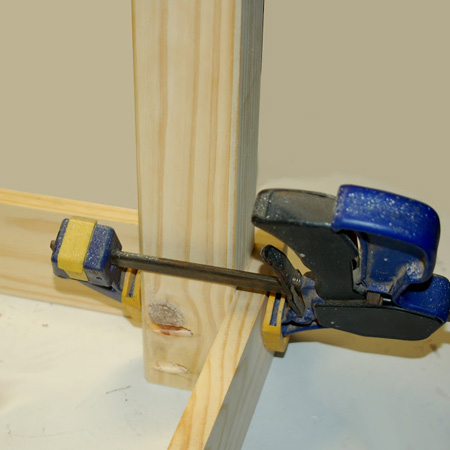 4. Apply wood glue to the top of the leg and clamp tightly into the corner of the frame.