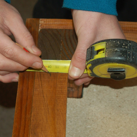 11. Measure and mark the centre of the rail along the width and length.