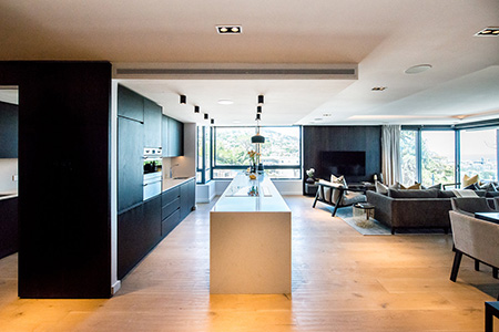 HOME-DZINE | Interior Design - For the second series of apartments, the designers opted for modern finishes and moodier tones, such as dark brown, grey and black, with hints of gold.