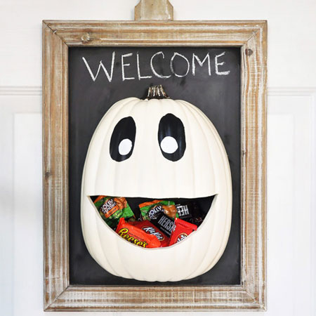 HOME-DZINE | Halloween Crafts - This candy door hanger can be mounted conveniently should the kids come knocking for trick or treat. This project by cherished bliss uses a plastic half-pumpkin, but you can substitute with a real pumpkin cut in half.