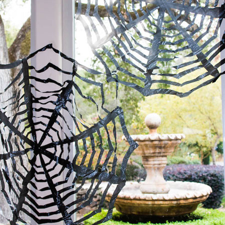 HOME-DZINE | Halloween Crafts - Make your own fun refuse bag spiderwebs. Found on fast forward fun, these spiderwebs will add a fun elements to windows and your Halloween decorations.