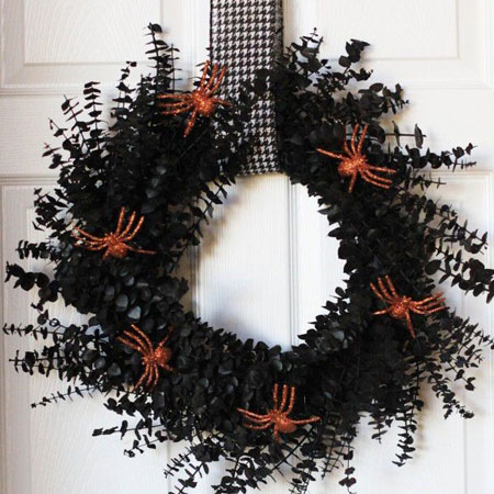 HOME-DZINE | Halloween Crafts - Grab some Rust-Oleum spray paint at your local Builders to make a scary wreath for Halloween. Cut foliage from the garden and spray this with matt black and then glue on spray painted plastic spiders.