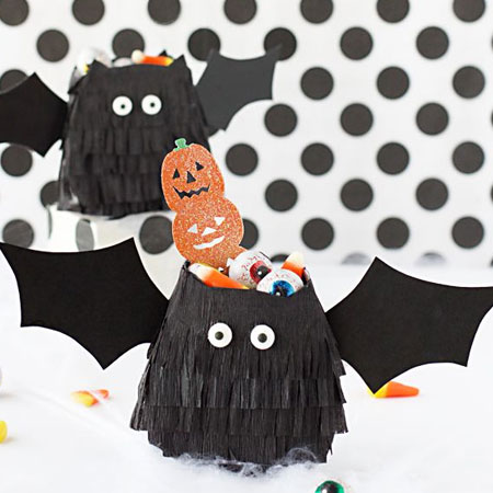 HOME-DZINE | Halloween Crafts - Make your own bat treat packs for handing out to the kids for Halloween. All you need is some black crepe paper and card, and craft glue or a hot glue gun.