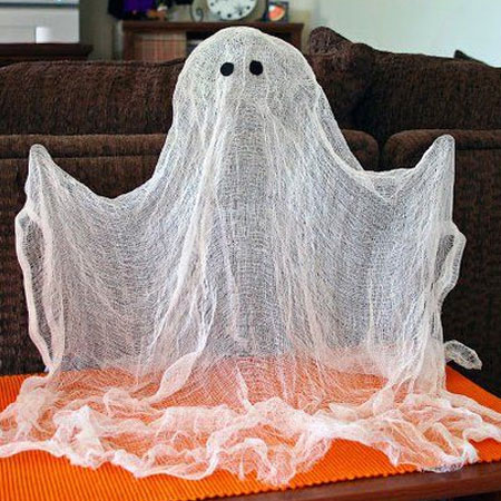 HOME-DZINE | Halloween Crafts - These floating ghosts are easy to make using cheesecloth and items you probably already have in the house.