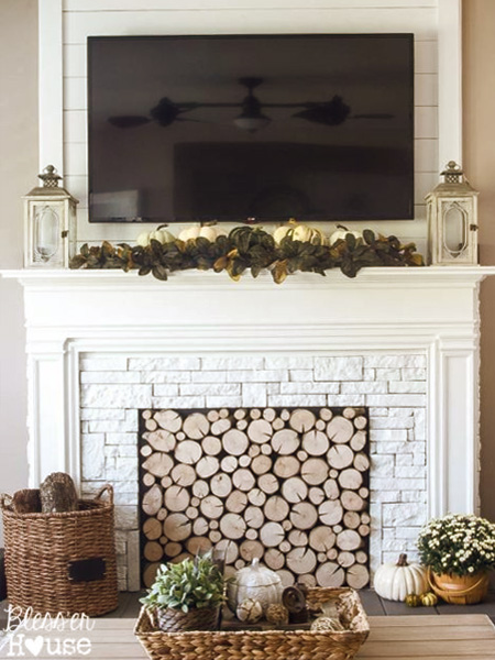 HOME-DZINE - Faux Fireplace Ideas - When building a faux fireplace, the most important aspect is to make the fireplace look like it belongs, and is not just stuck there. Draw up a basic idea for the fireplace and look how you can incorporate add-ons to make it an authentic feature.