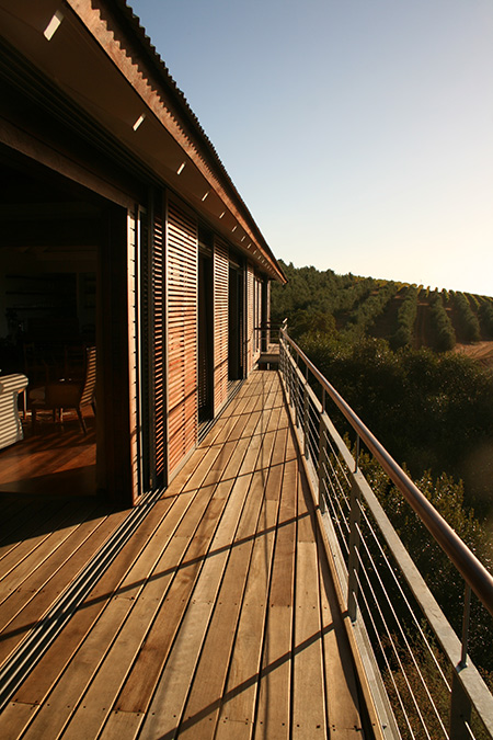 HOME-DZINE | Timber Homes - Nestled in a valley rich in indigenous flora and fauna, Hidden Valley Wine Farm's architecture pays careful homage to its surrounds. With much the same approach to commissioning the guest accommodation on the farm, Rustic Homes were briefed to build two luxury wooden cabins, including a deck and pool area seamlessly connecting the two, above the farm's olive groves.