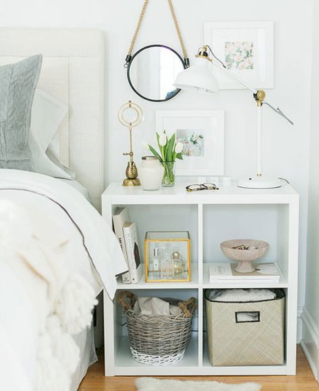HOME-DZINE | Bedroom Ideas - If you opt for a bedside table with open shelves, use baskets and pretty boxes to contain the clutter. Too much stuff in a small or medium bedroom can quickly make the room feel clutter and messy.